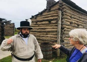 The Lewis and Clark State Historic Site in Hartford, Ill., commemorates Camp Dubois, where the Lewis and Clark Expedition stayed from December 1803 to May 14, 1804. The site includes a top-notch museum and a replica of the camp. Here, interpretive coordinator, Ben Pollard, offers historical information to Linda Vogt, a volunteer for Lewis and Clark activities in Jefferson City, Mo.